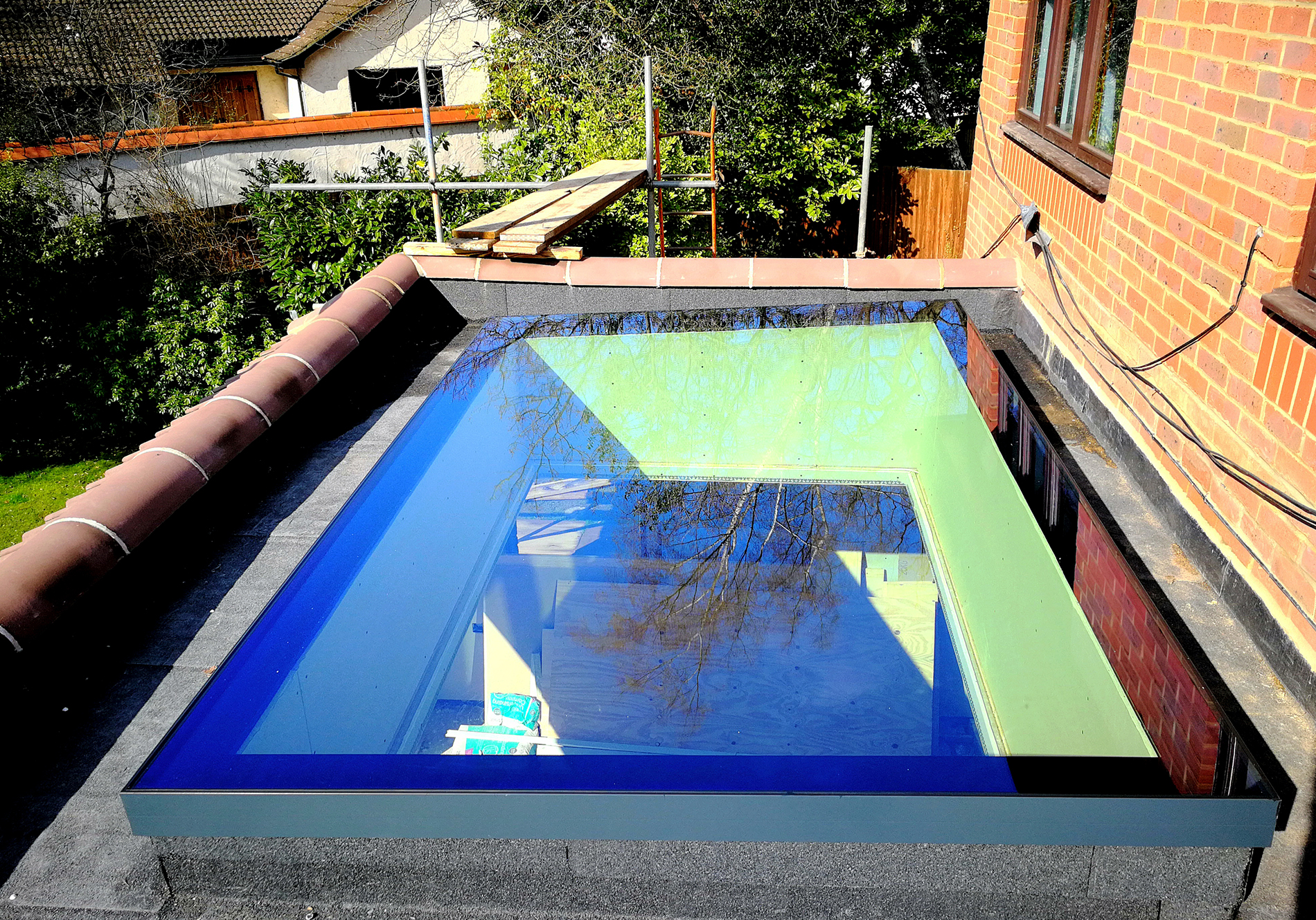 largest exact pure glass flat roof light