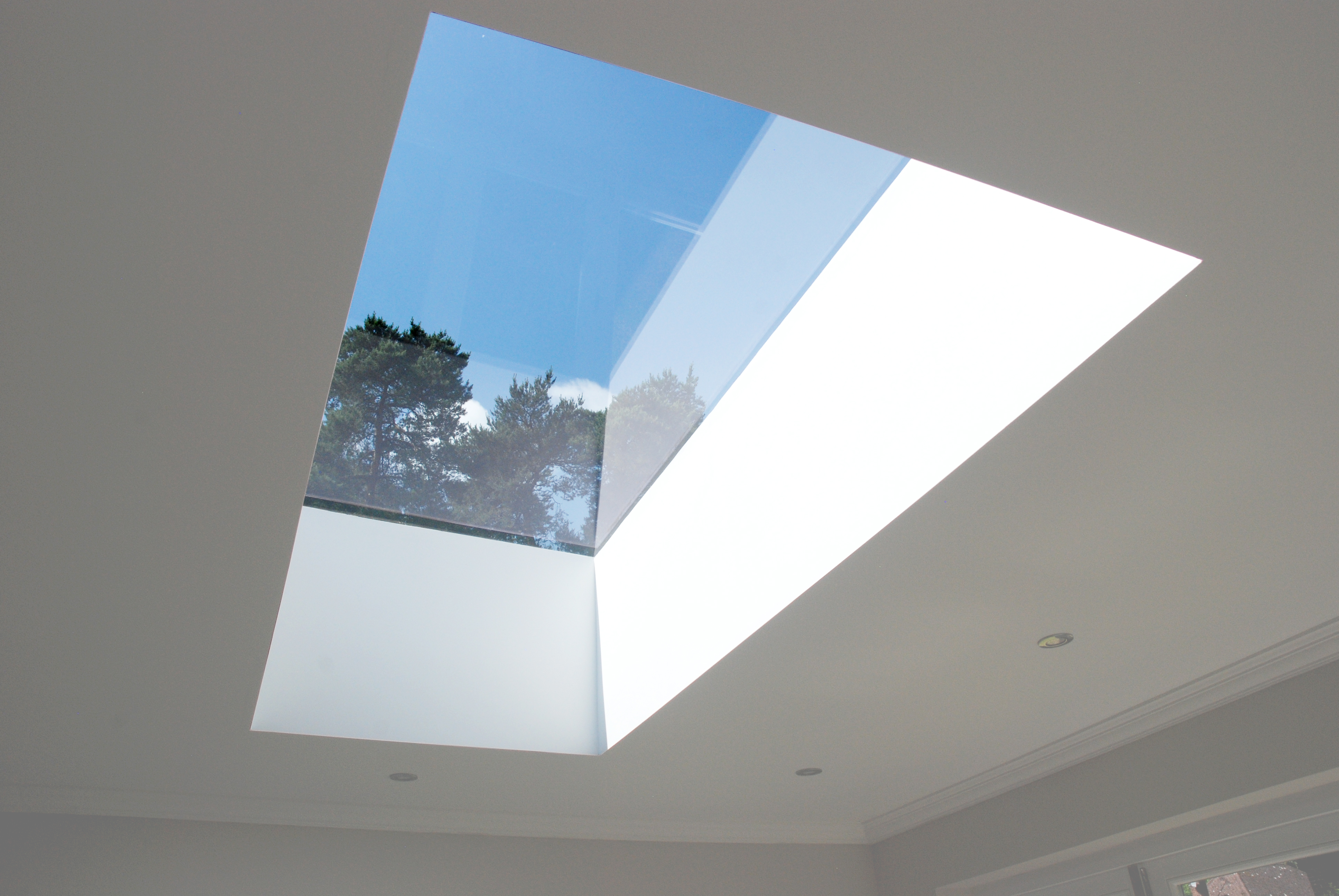 pure glass flat roof light provides an uninterrupted view above and doesn't affect the external view of the home