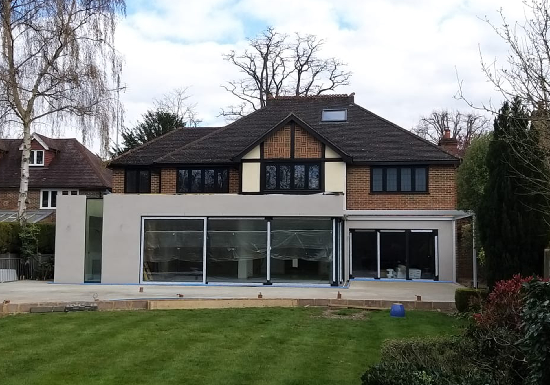 two sets of CP130 Reynears sliding doors on weybridge rear extension