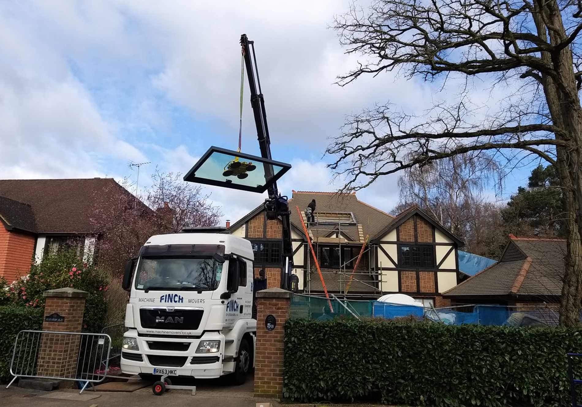 pure glass flat roof light craned into place in Weybridge home