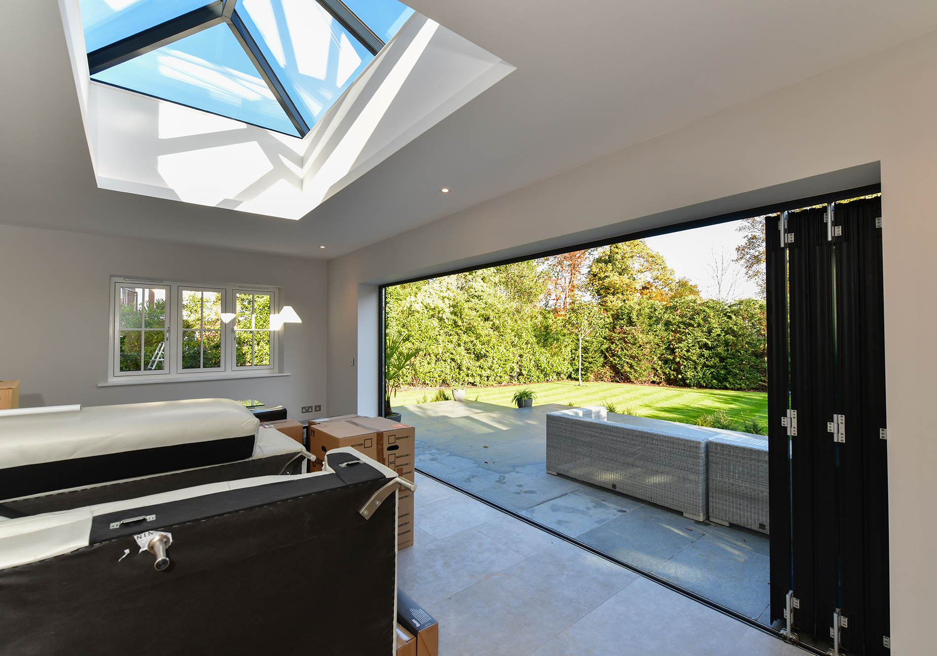 kitchen dining area featuring aluminium roof lanterns and fD85 bifold doors