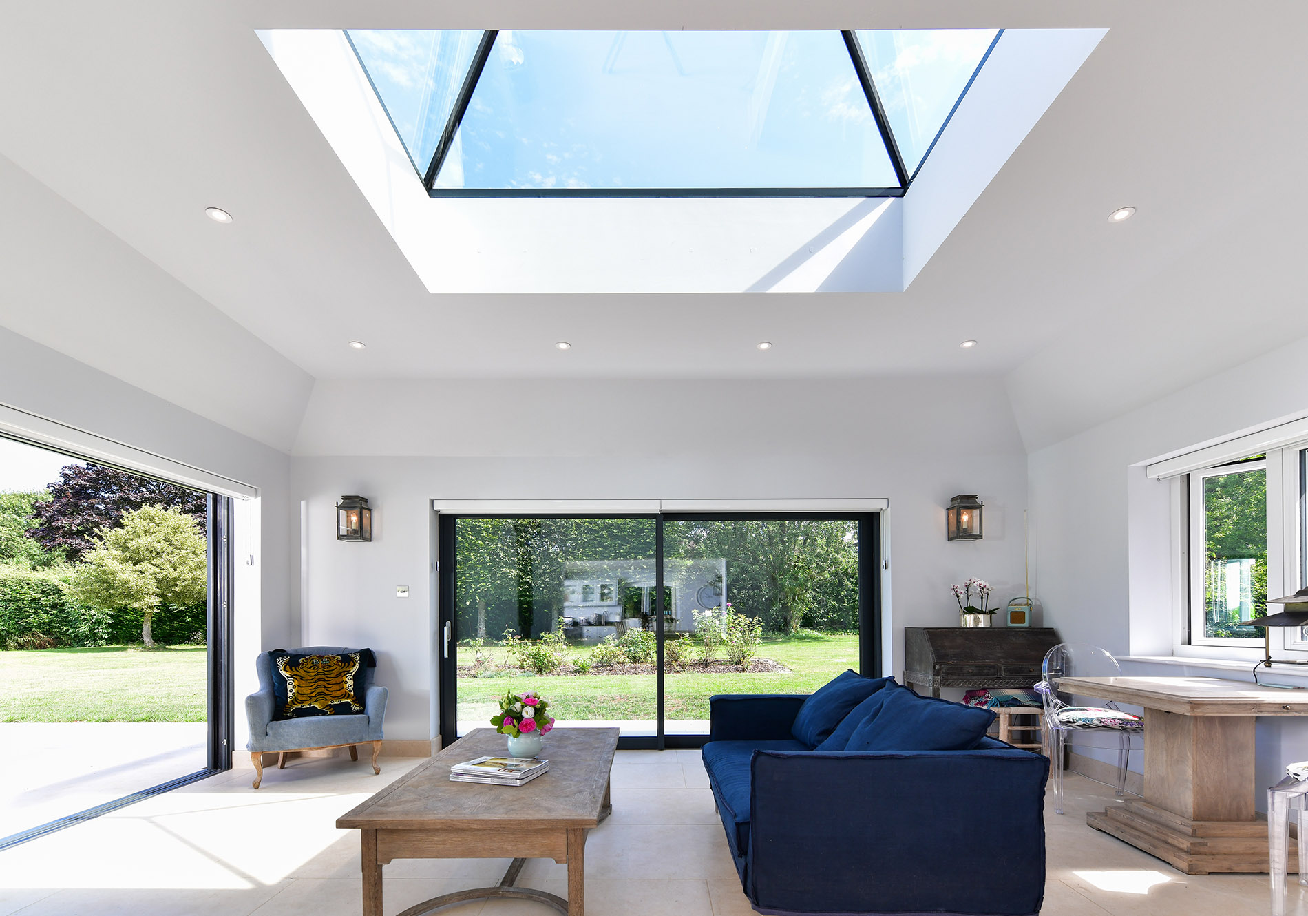 combining glide s slidng doors with a pure glass roof lantern and residence 7 windows on a rear extension