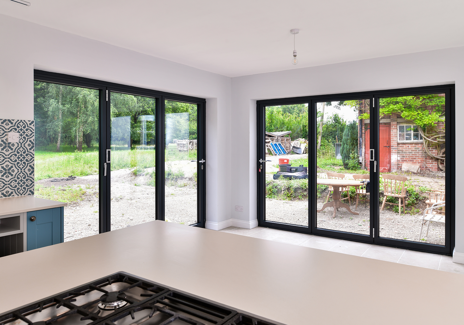 views onto the garden through 2 sets of FD85 bifold doors