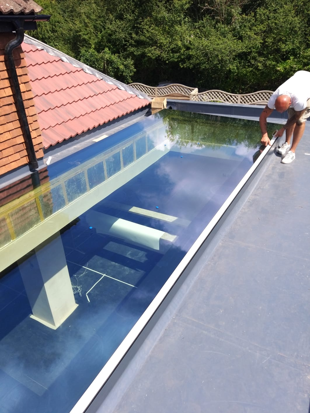 finishingoff the install of the largest pure glass flat roof light