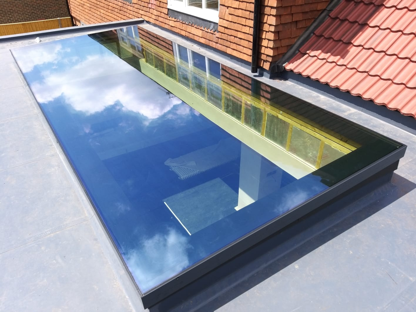 largest pure glass flat roof light